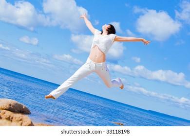 Girl in white in the air