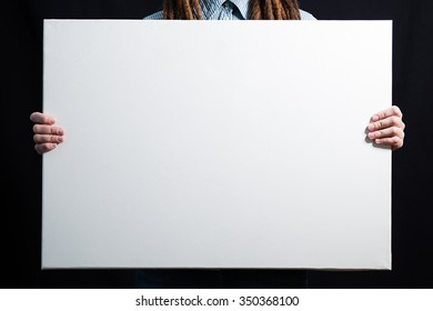 girl with a white canvas in hands