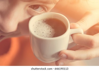 Girl with a white cup of coffee in his hand. Toned