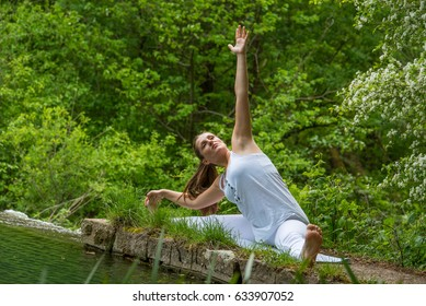 Girl in white doing yoga in nature