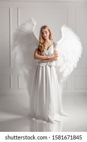 Girl in white dress with angel wings