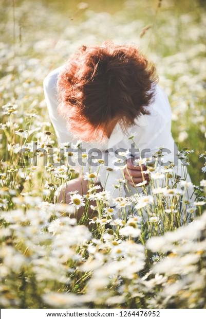 girl-white-dress-buried-flowers-600w-126