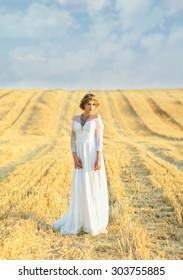 girl in a white dress in a field