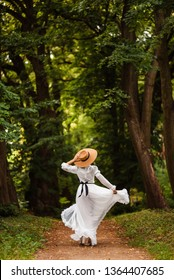 Girl in white dress in the forest