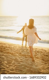 Girl in a white dress  goes on a date at the sea