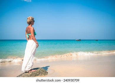 Girl in white dress on the background of the sea