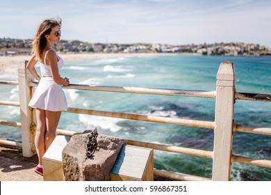 girl in white dress on city ocean coast bondi beach in sydney