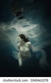 Girl in a white dress under the water
