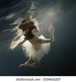 Girl in white dress underwater