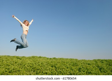 The girl in white jumps in the field