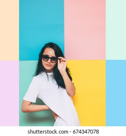 girl in a white oversize dress for brides smiling and holding round sunglasses. summer wedding concept, in the style of minimal