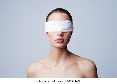 Girl with white ribbon on her eyes