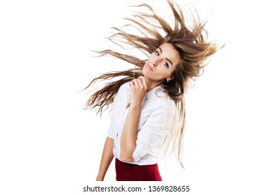 girl in a white shirt and burgundy skirt on an isolated white background, with a flying hairstyle