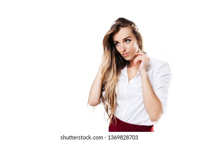 girl in white shirt and burgundy skirt on an isolated white background, looks away