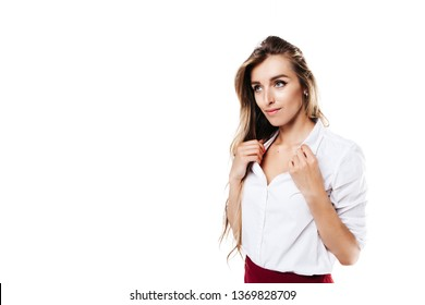 girl in white shirt and burgundy skirt on an isolated white background holding on to her shirt