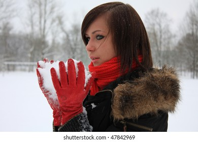 Girl with white snow in her hands