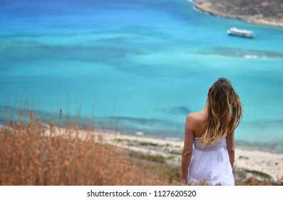 the girl who observes the beautiful Balos Lagoon in Crete