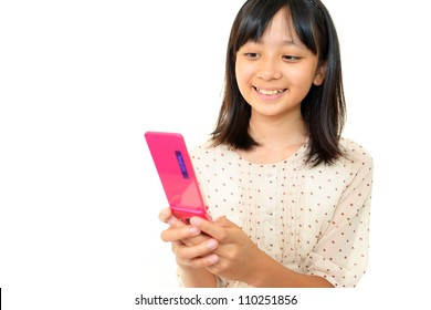 The girl who watches the screen of the cell phone happily