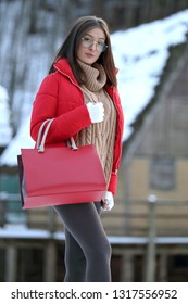 Girl with winter clothes in outdoor setting