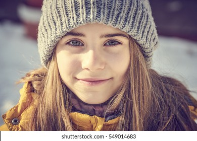 Girl with winter hat and blonde hair