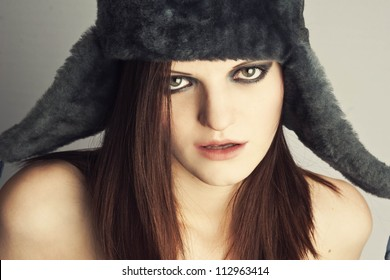 Girl in winter hat and bright make-up