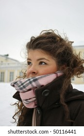 girl in winter near yellow building in St-Petersburg