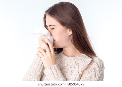 girl wipes her nose kerchief closing your eyes is isolated on a white background