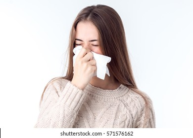 girl wipes the nose is isolated on a white background