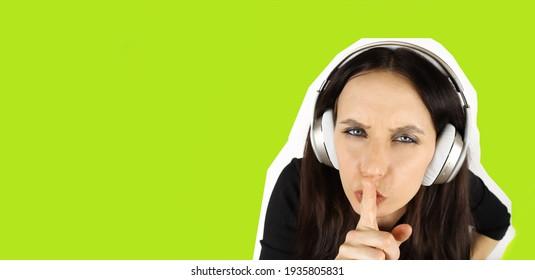 girl in wireless headphones shows shh gesture. Magazine modern style. Horizontal banner
