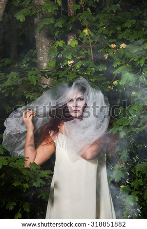 Girl In Witch Costume For Halloween In A Forest. Beautiful Zombie Bride In  Halloween.