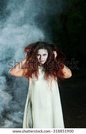 Superior Girl In Witch Costume For Halloween In A Forest. Beautiful Zombie Bride In  Halloween.