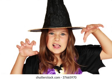 A girl in a witch's costume making a scary face
