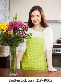 Girl withbeautiful bouquet of flowers cutting