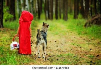 "the girl with a wolf go on the wood.  the fairy tale "" Red Riding Hood"""