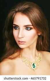 The girl, a woman, a beautiful young girl with professional makeup eyes
