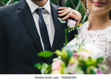 girl, woman in a long white dress with a wedding bouquet along with a bearded bridegroom after a wedding ceremony on a walk in an exotic autumn park.