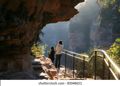 Girl and woman observing beautiful landscapes of Blue Mountains, Australia.