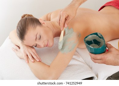 girl woman at a reception by a massage therapist, massage parlor