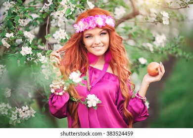 girl woman red-haired in spring garden apple