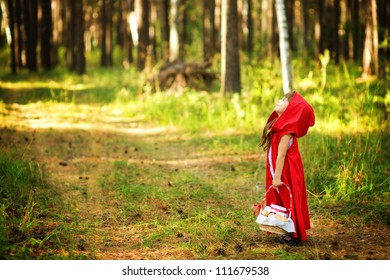"the girl in the wood looks up.  the fairy tale "" Red Riding Hood"""