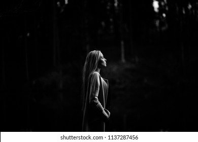 The girl in the woods.Reverie.Black and white photo