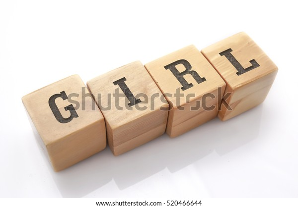 girl word made with building blocks isolated on white