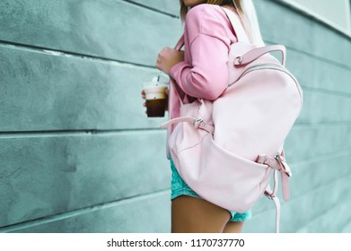 A girl wore pink sweater,jean and  Shoulder bag pink walking in street.