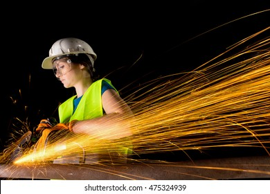 girl working with angle grinder
