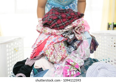 The girl is working hard at home is washing clothes.