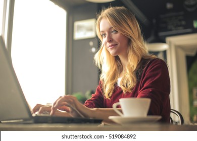 Girl working at her laptop