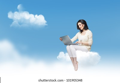 Girl working on computer in sky