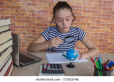 Girl working on his homework. young attractive student Girl studying lessons. Thoughts, education, creativity concept