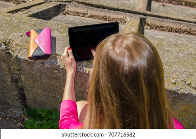 girl working on a tablet computer outside the office