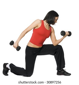 Girl is working out with dumbbells. Isolated on white